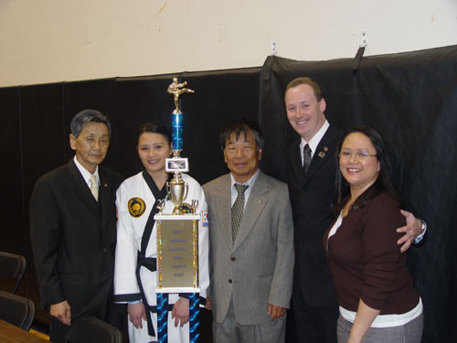L to R: Grand Master C. I. Kim, Shaina Kennedy (Grand Champion of Tournament), Grand Master M. K. Kim, Master Patrick Kennedy, and Master Marie Kennedy